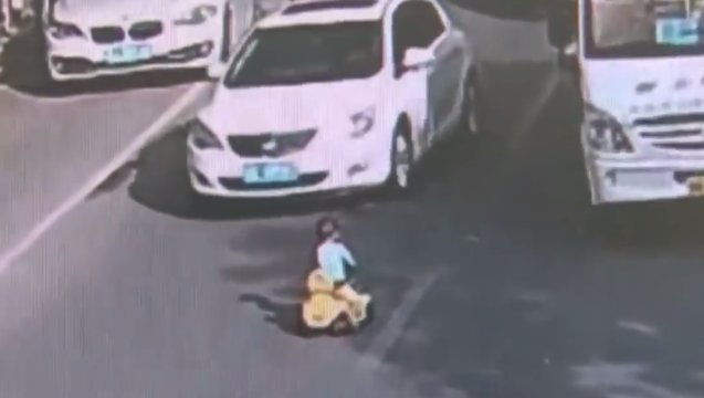 Terrible: Child Is Caught Riding His Tricycle Into Rush-Hour Traffic!
